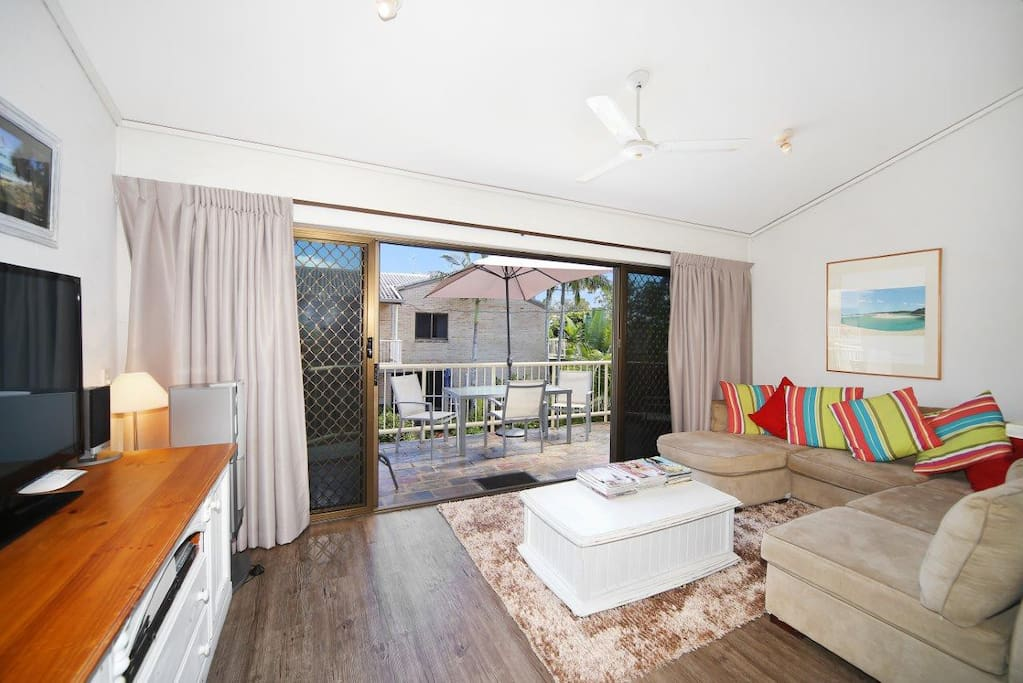 Living room with large balcony with Noosa river views.