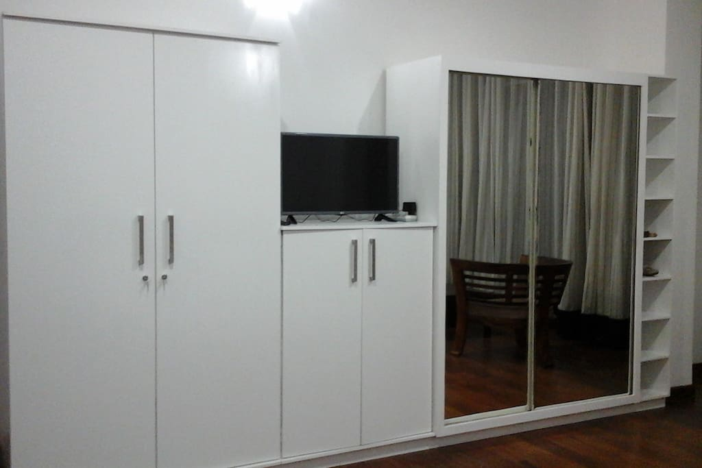Master BR with a TV and built in wardrobes