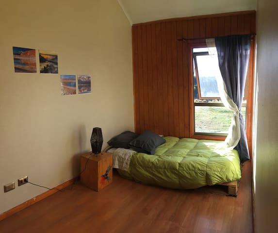 Dormitorio con hermosa vista a pasos del centro