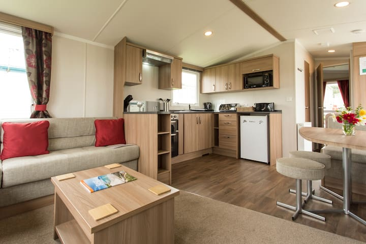 Brand new modern caravan. Sleeps 6. Decking & BBQ