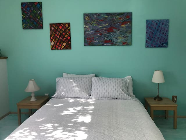 Motion of the Ocean room. This is a 2nd bedroom which can be booked for extra $$ a night. Comfy Queen mattress on a  wooden bed frame.  Please let us know if you prefer this room to the Queen's Room. Otherwise it is kept locked during your stay.