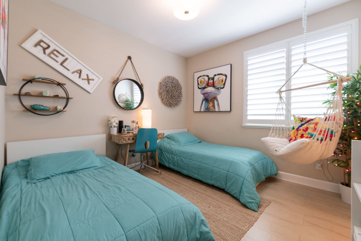 Happy Home, a cozy colorful feel good room that would help you relax and be happy. Pictures were taken with wide angle lenses which makes one of the beds look bigger.  They are both twin size beds.