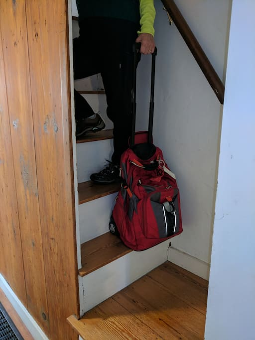 Steep, narrow stairs up to Artsy upstairs bedroom - and down to shared bath.
