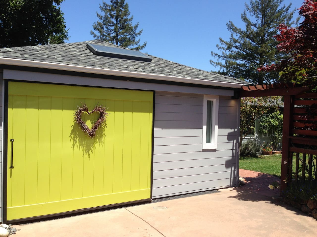 Can't miss the bright garage door and entrance to our home through the yard. Our home is set back behind another and accessed via the driveway. Very private.