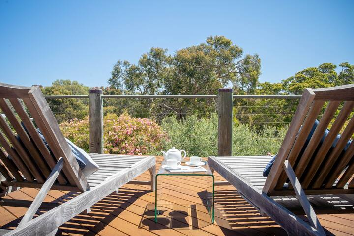 Relax on the deck, listen to the birds and watch the nearby grazing kangaroos.