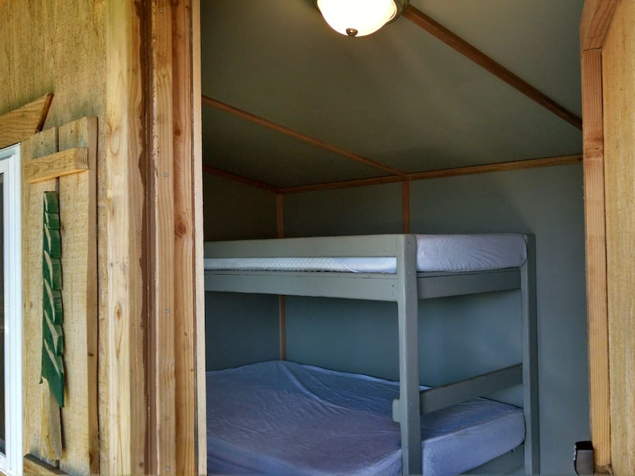 Trundle-style bunks with comfy memory foam mattresses.