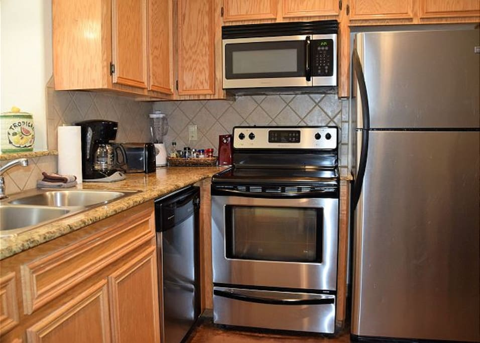 Fully equipped kitchen with granite counters and all appliances.
