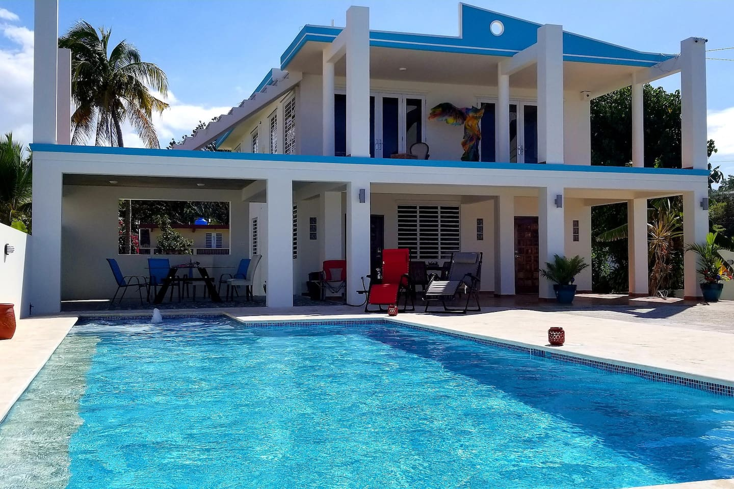 Enjoy the ocean view while relaxing on the ledge of our 30' sparkling clean, custom freshwater pool. Easy to step down. Surrounded by local handcrafted Coralina that's nonslip & never gets hot to the touch.