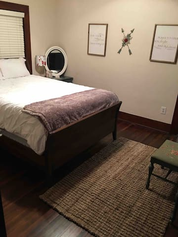 Master bedroom has two closets and a queen sleigh bed.