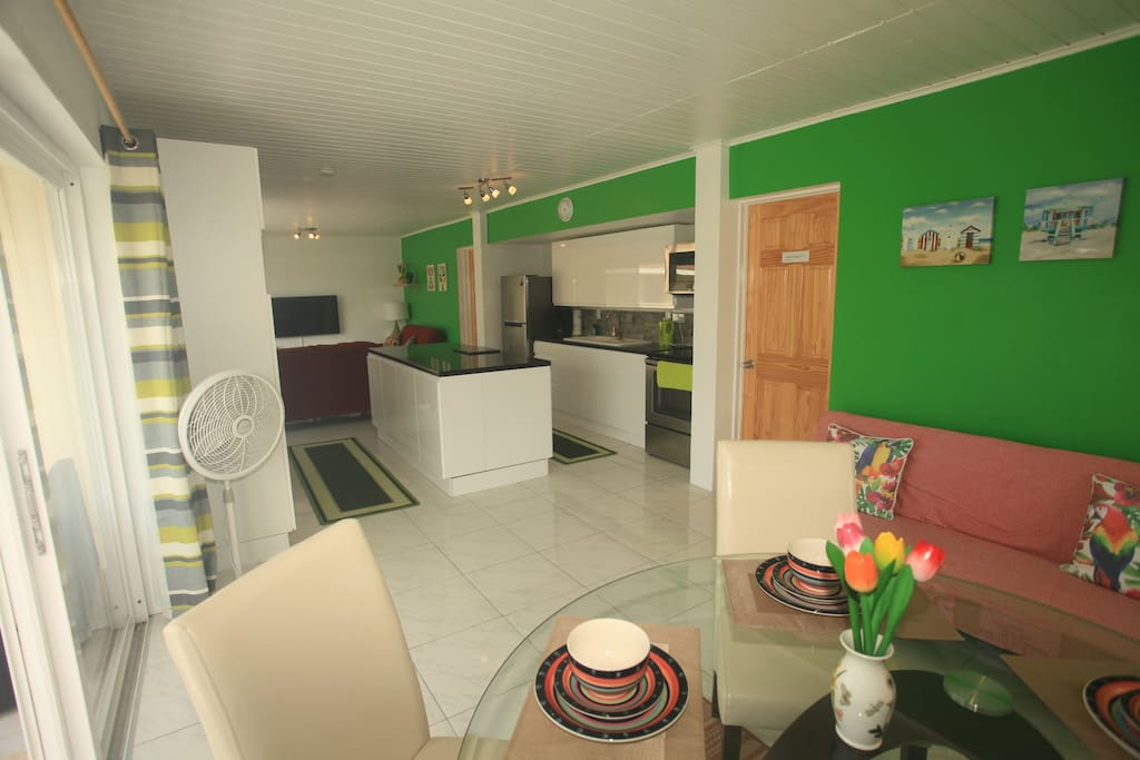 LARGE DINING AREA WITH FULLY FITTED KITCHEN AND LOUNGE WITH 48INCH SMART TV WITH NETFLIX FOR YOUR ENTERTAINMENT