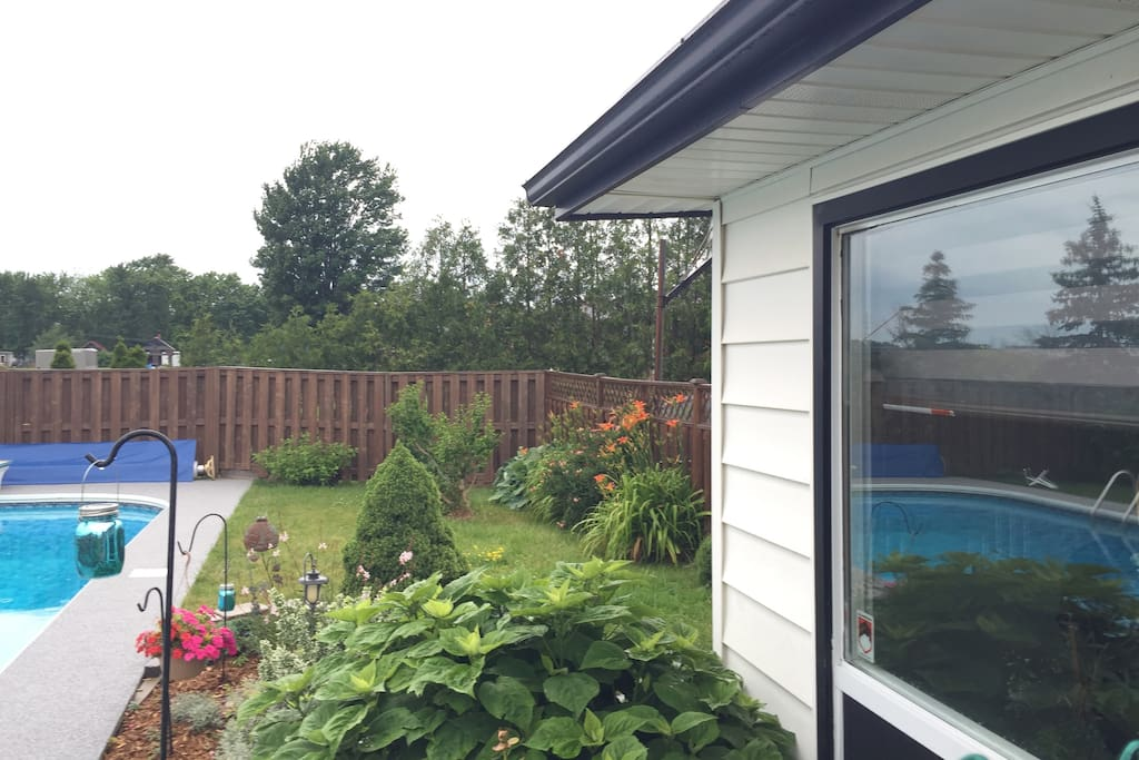 Beautiful backyard with pool and bug free enclosed Cabane with built in fire pit  for evening bonfires.