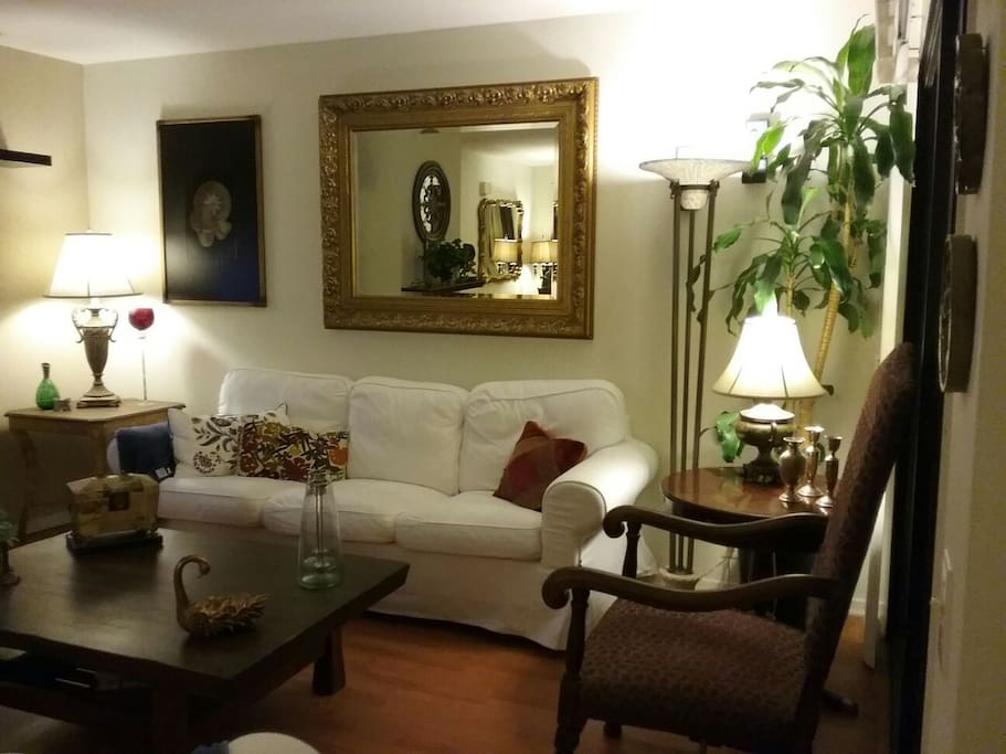 Comfortable couches and very clean white linen