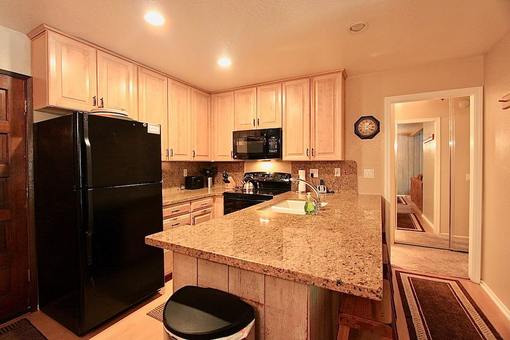 Remodeled kitchen with granite counters and stocked with everything!