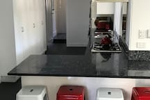 Kitchen with 5 burner gas hob and electric oven