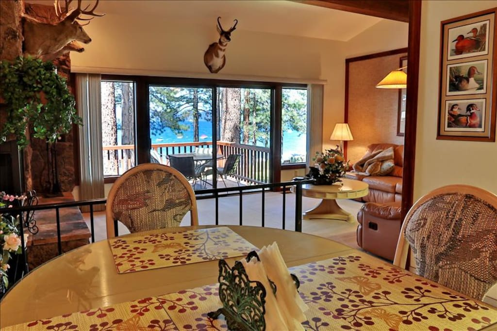 Dining room table opens to living room & lake