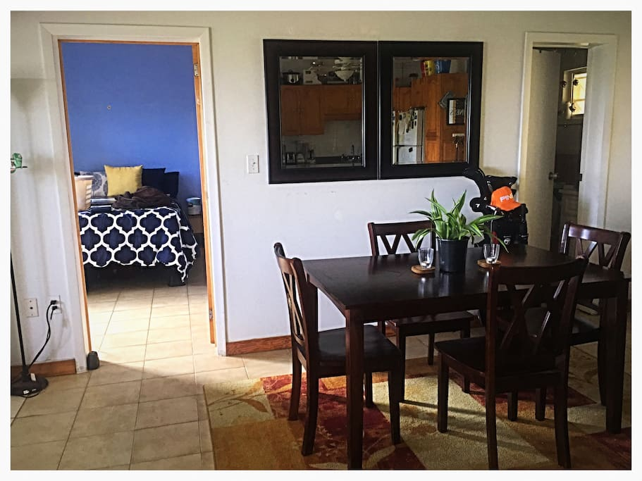 Guest bed and bath are seen in this picture. The dining table separates them by about 15 feet.