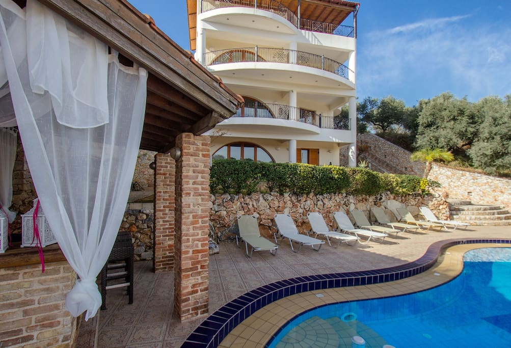 A charming pool, pool bar, outdoor furniture, barbecue facilities
