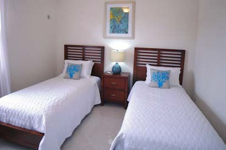 Bedroom 4 is air conditioned and has two single beds that can be pushed together to create a king size bed.
