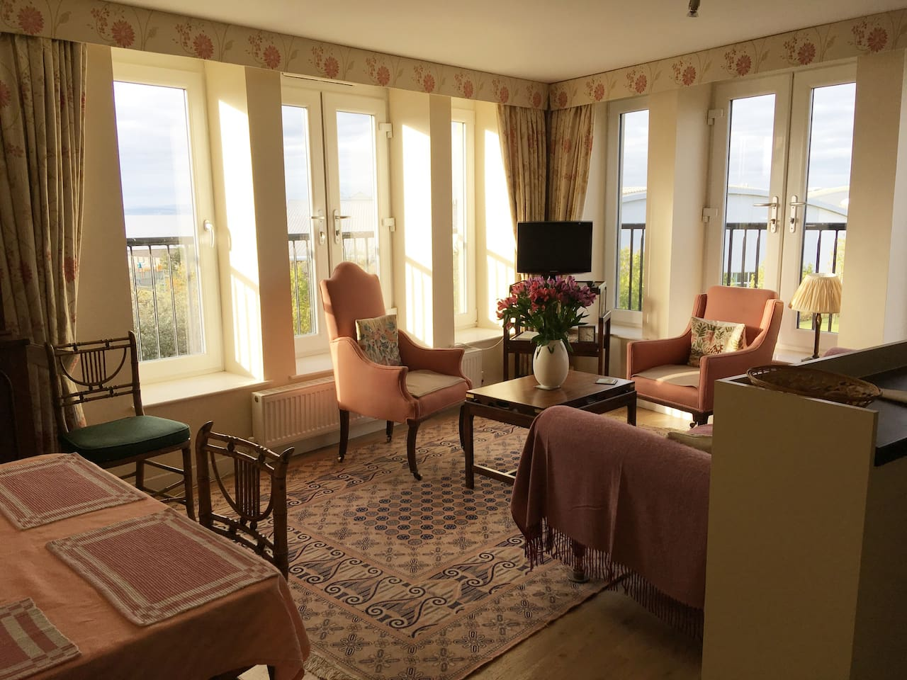 Our bright and sunny lounge with panoramic views over the Firth of Forth