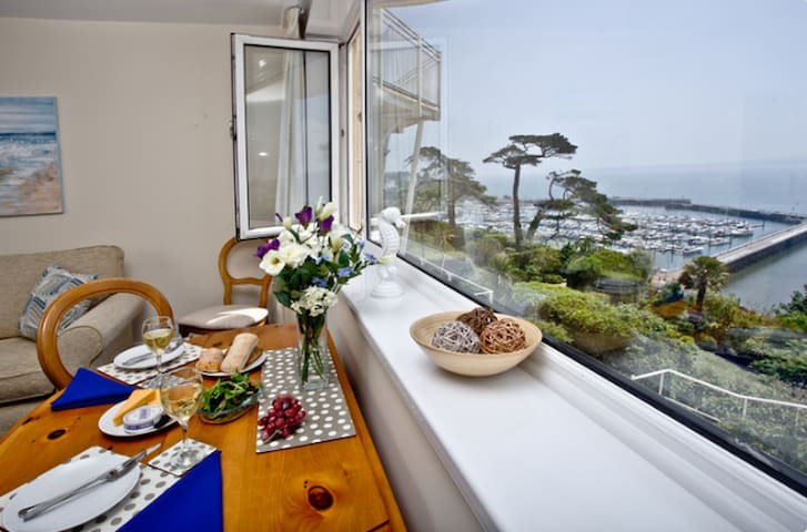 Open plan living and dining area, with the amazing views