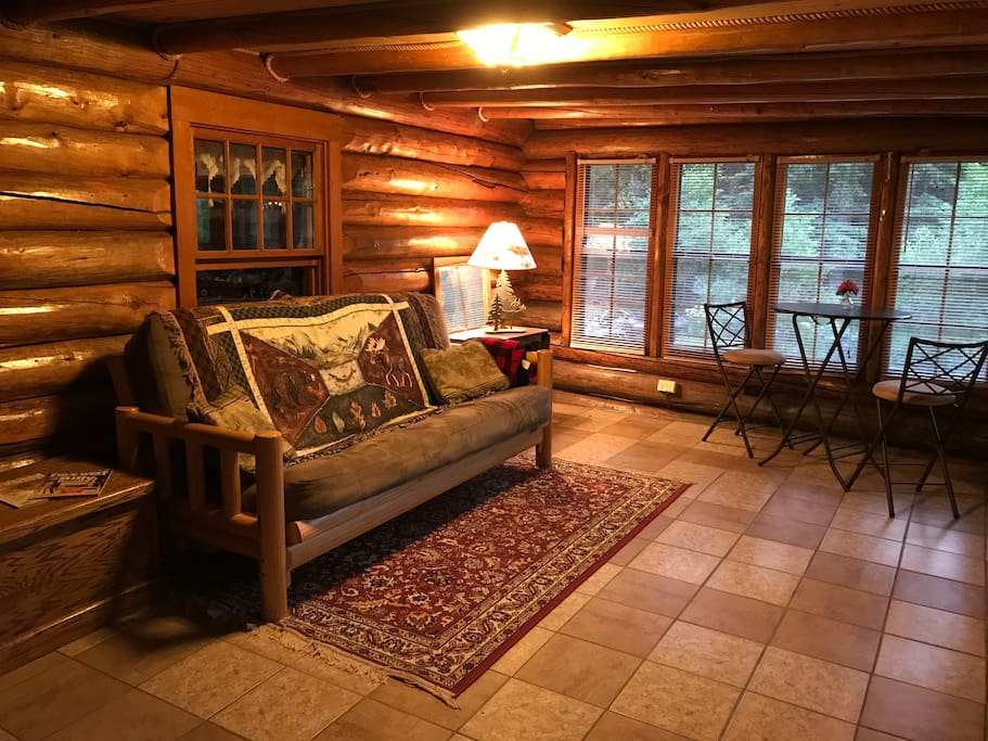 Unwind in the cozy sunroom and enjoy the breathtaking vistas of the canyon. The futon folds down as a double bed.
