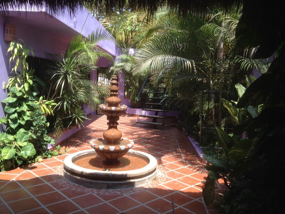 Shared Courtyard - with entrance to property behind the fountain.