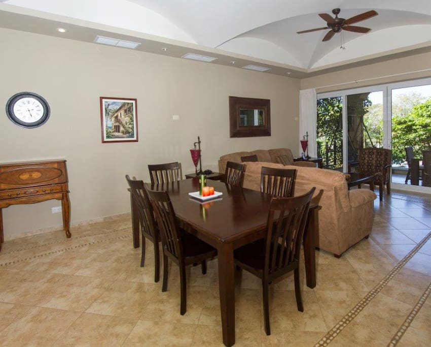 Dining area with view towards balcony and garden area