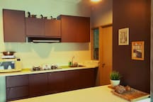 Induction cooker, microwave and kettle provided in kitchen