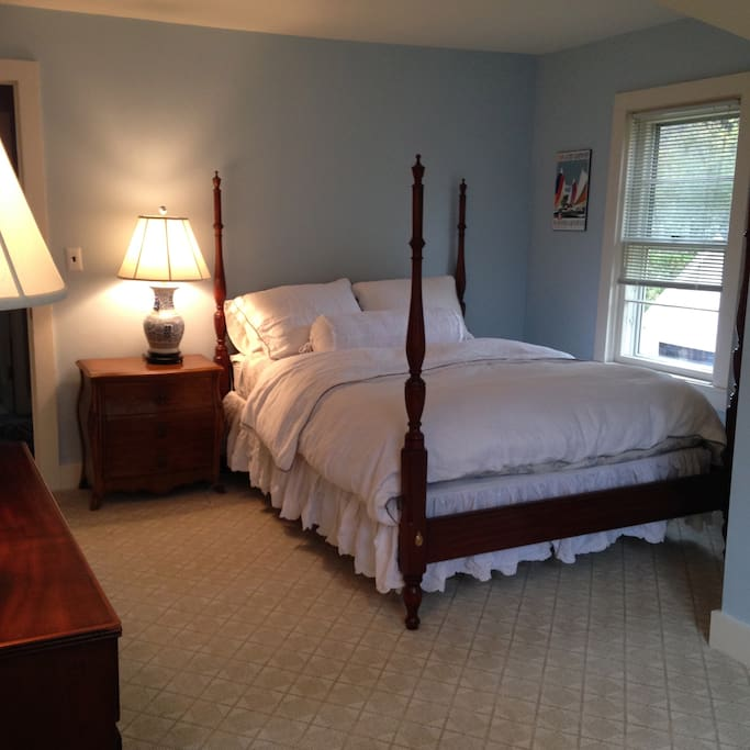 Queen size room with two lake view windows.