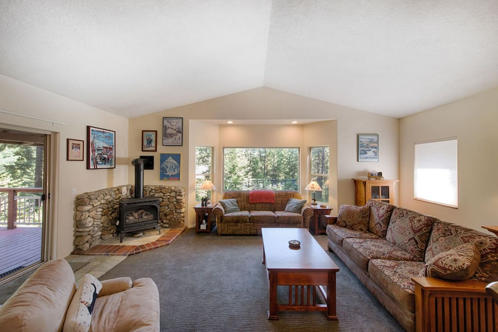 Open and bright, living room with lovely views.  Deck access.