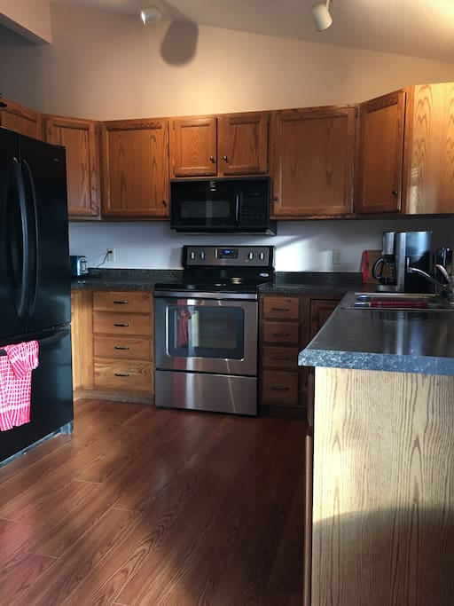 Updated kitchen with quality appliances, and all the plates, serving dishes, pots, pans and the like.