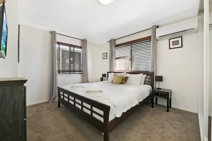 Bedroom with king bed + TV + air con (main level)