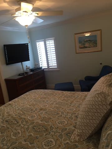 Master bedroom showing TV on wall