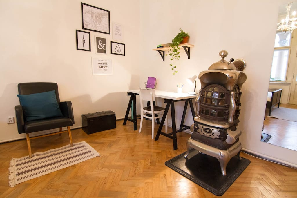 Working desk, the best place to plan your trips around Prague. 100 years old original American stove is pretty cool (or hot? :))