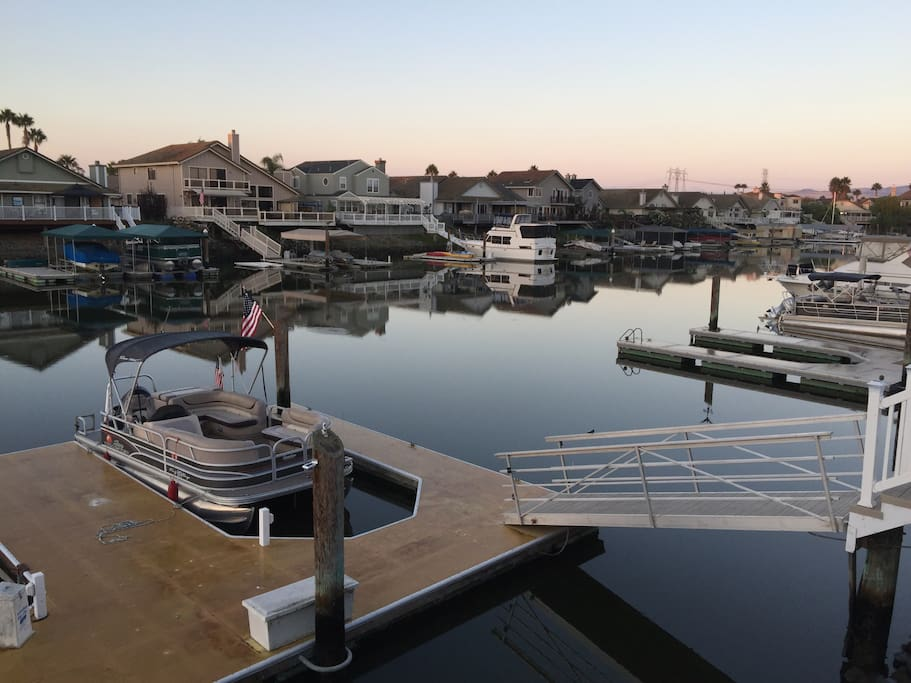 As example of dock space (shown is a 20ft pontoon boat to give you an idea. This is not a rental boat and does not come with the home) enclosed area is 12ft wide. Room for larger boats - up to two other boats on the outsides. Fast water is about 20/30 min.