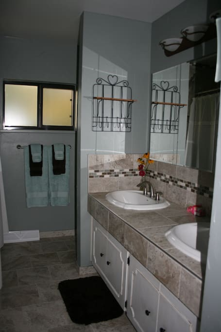 Doubles sink large bath with tub and shower