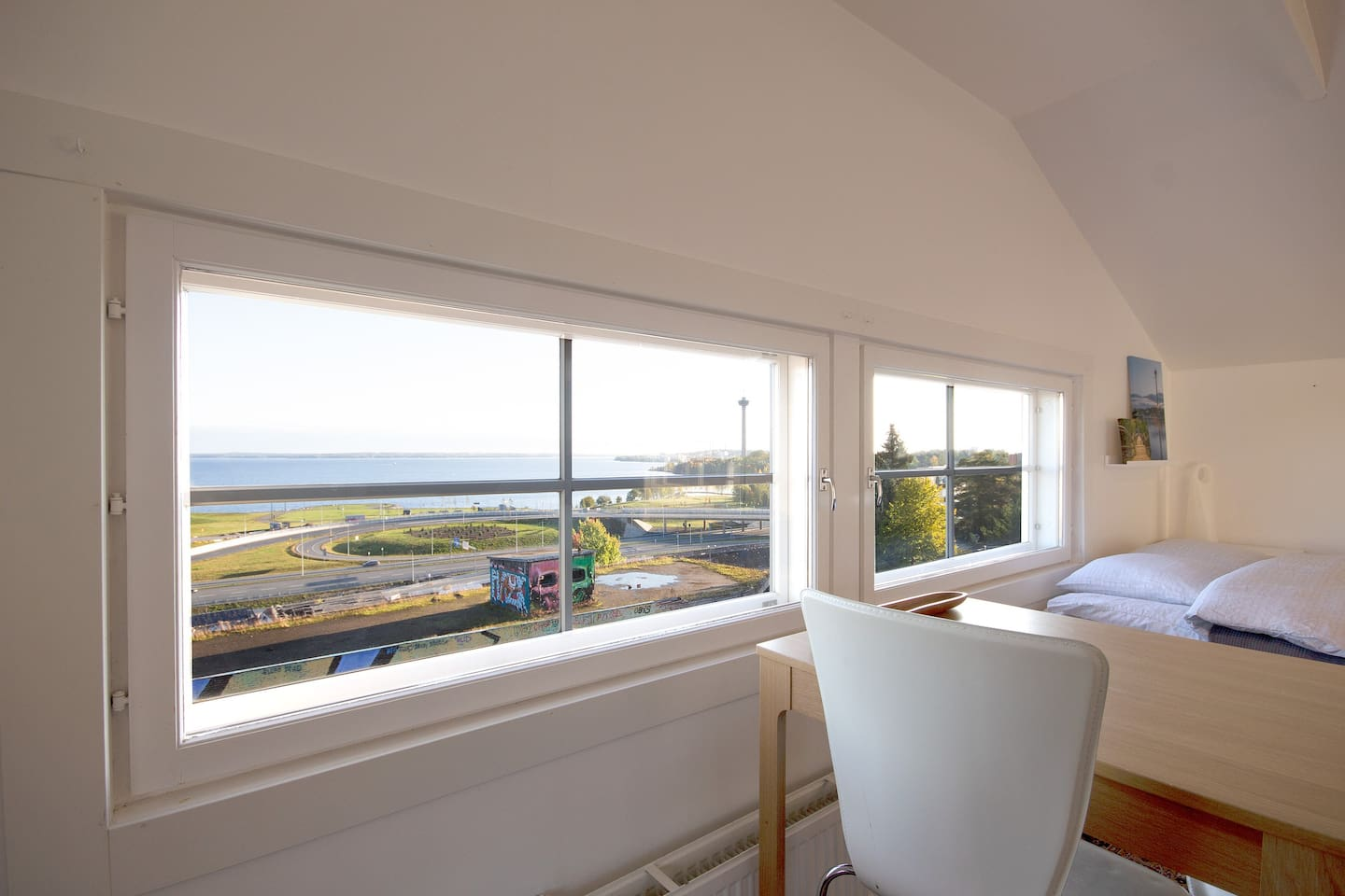 The view opens up from the sofa, dining table and bed