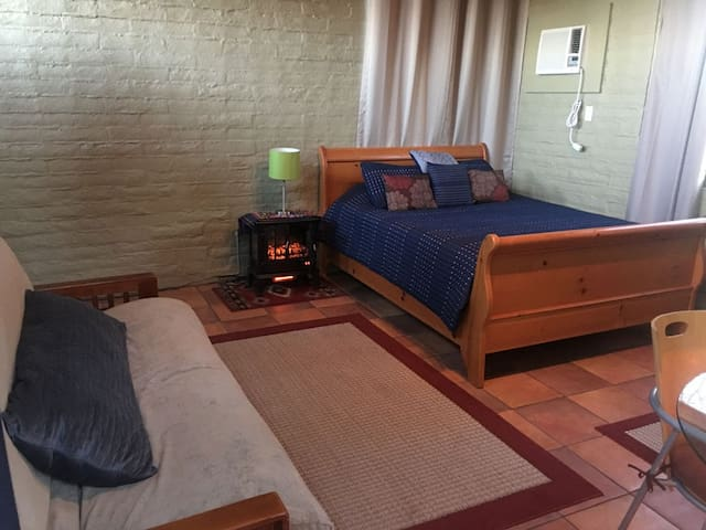 Futon, Queen size sleigh bed, and table for 2 for wifi time