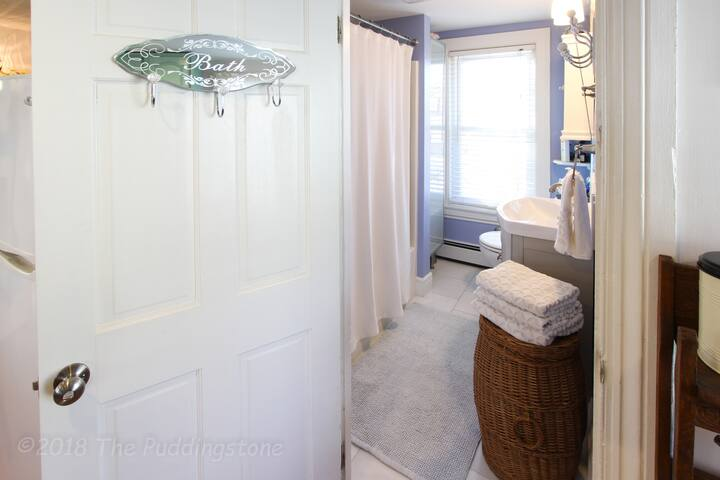 Private bathroom with tub and shower