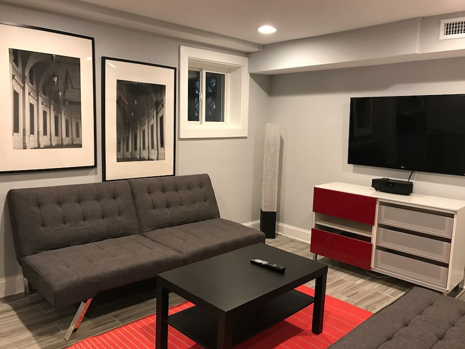 Living Room with futon and single sleeper can sleep 2 or 3.  Air mattress can be provided upon request. TV has Chromecast and digital broadcast channels.  Bose speaker connects devices with provided aux cable (3.5mm).