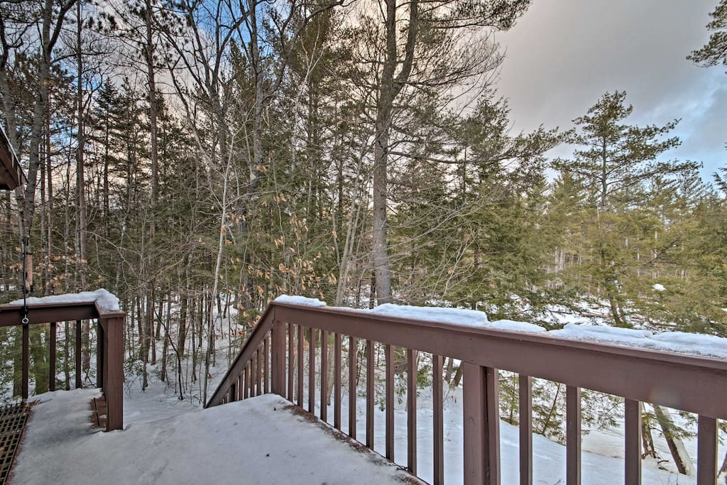 Step onto the back porch and take in the beautiful forested scenery.
