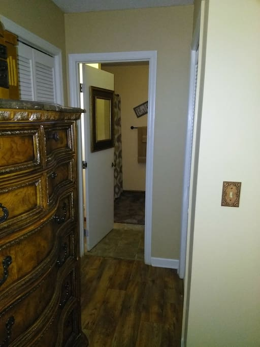 Master bedroom with king size bed with full size bathrom w/closets in bedroom and bathroom.