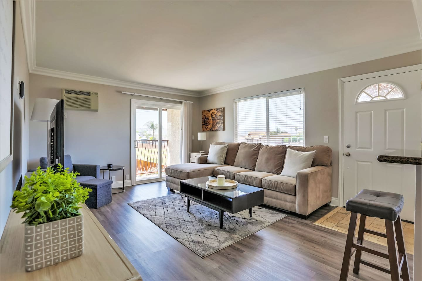 """Spacious Living Room Area with Ample Seating & 55"""" Smart TV"""