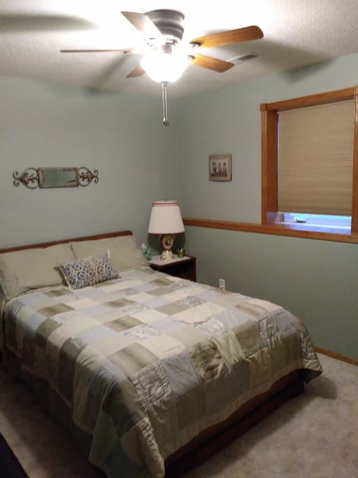 Comfortable bedroom with plenty of storage for longer stays.