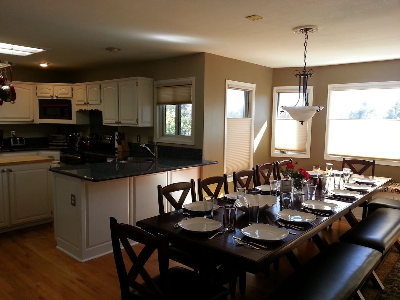 Large dinning area with an open kitchen.