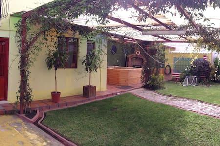 cozy two floors little house,nice garden. - Otavalo