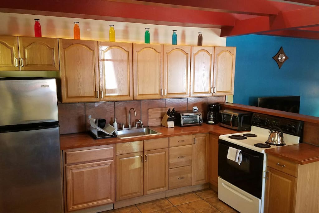 Kitchen with new appliances,  toaster over, and microwave.