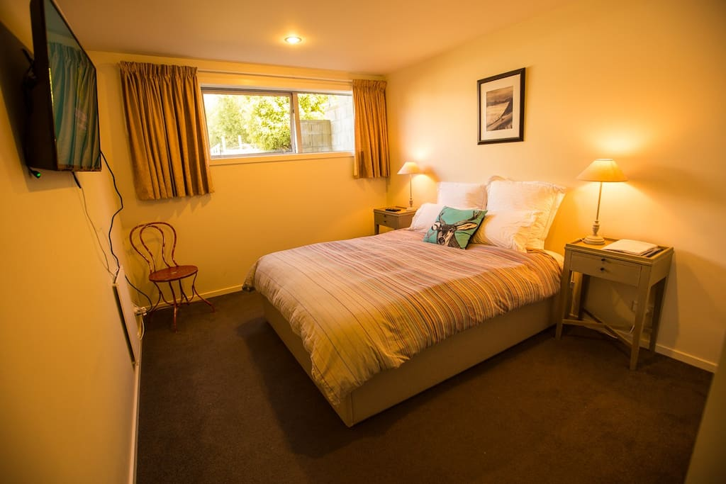 Queen bedroom with plenty of storage space, flat screen TV and a super comfy bed.