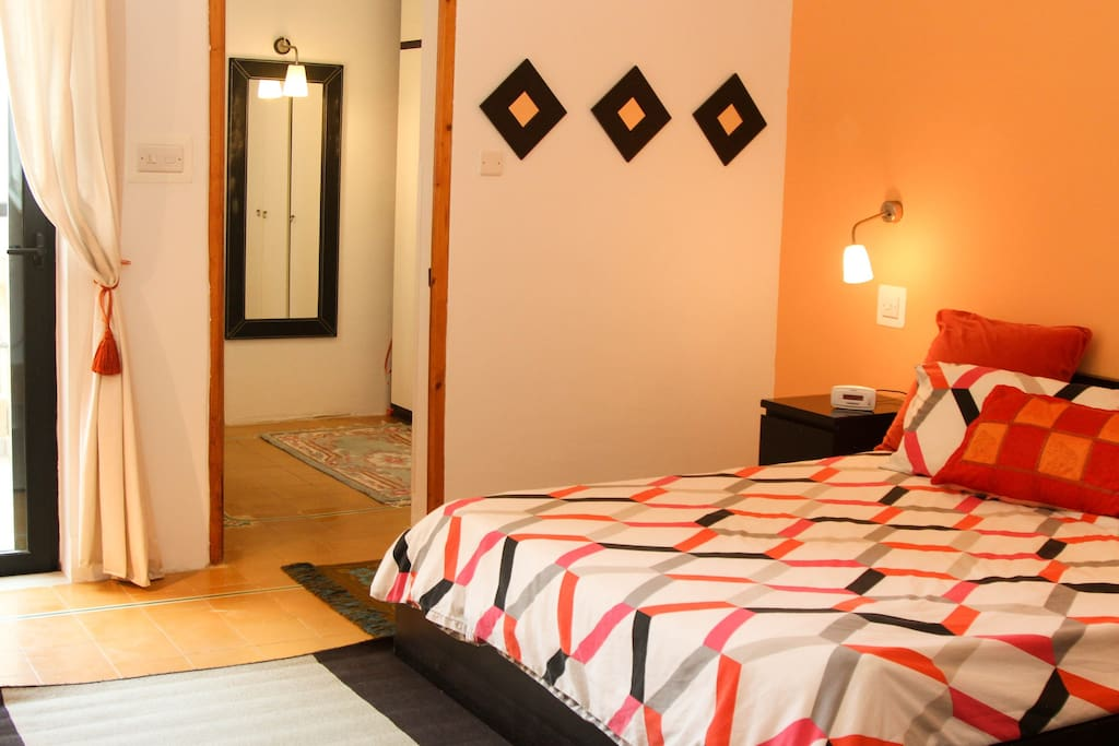 Private double king bedroom with balcony and private en-suite bathroom with bath and shower