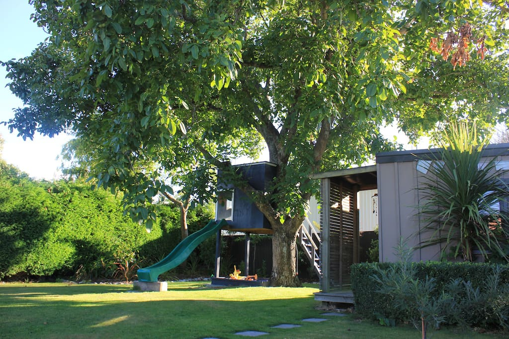 Beautiful back garden, private and secluded, great for kids and adults to unwind. You can also see here the Walnut tree the cottage was named after.